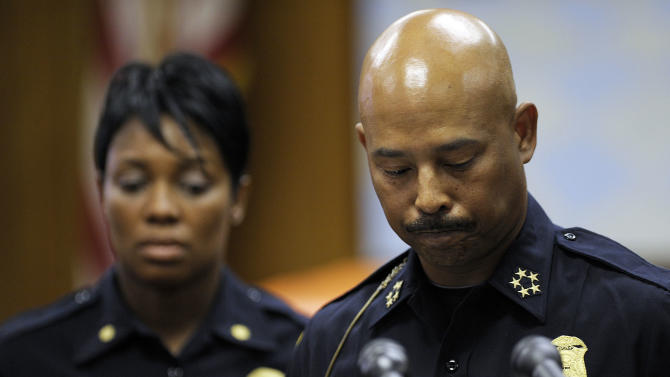 Police Chief Ralph Godbee Jr. pauses for a moment during a question about the death of Adaisha Miller, 25, of Detroit, this weekend as Inspector Lashinda Houser listens in the background at Police headquarters, Monday, July 9, 2012. The death of Miller, shot in the chest after she hugged an off-duty police officer from behind during a party, is a tragic, unfathomable accident, Detroit's police chief said. (AP Photo/The Detroit News, Clarence Tabb, Jr)