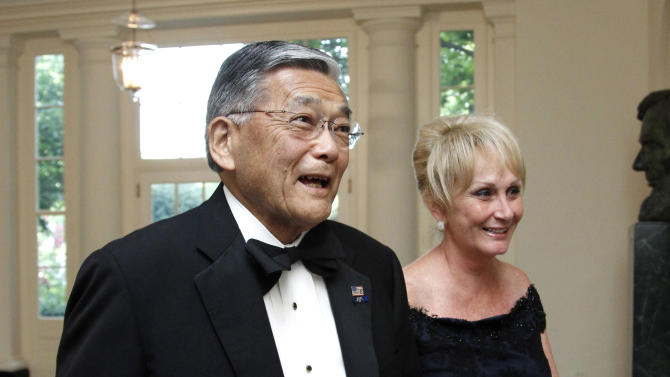 FILE - In this June 7, 2011 file photo, former Transportation Secretary Norman Mineta, and his wife Deni arrive for a State Dinner at the White House in Washington. The surveillance of Muslims by the New York Police Department, detailed in a series of recent stories by The Associated Press, brought back memories for him when at age 11 he and his family were interned during World War II. (AP Photo/Manuel Balce Ceneta, File)