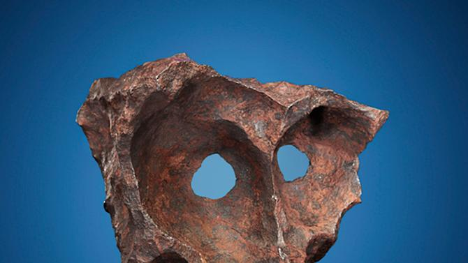 This undated photo provided by Heritage Auctions shows a naturally sculpted Gibeon iron meteorite discovered by indigenous tribesmen in Namibia with a metal detector. It will be offered at a sale of more than 125 meteorites on Oct. 14, 2012 and is estimated to bring $140,000 to $180,000. (AP Photo/Heritage Auctions)