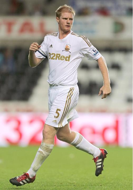 Leeds have swooped for Swansea midfielder Alan Tate