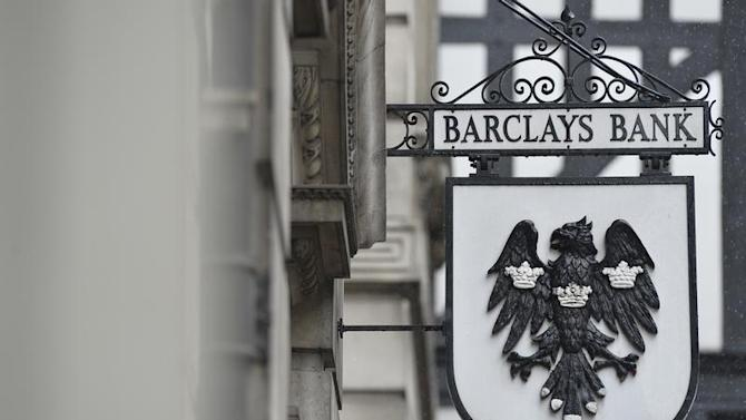 A logo hangs outside a branch of Barclays bank in London