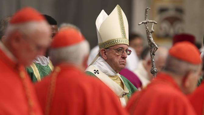 Pope Francis arrives to lead the opening mass for the synod of bishops on the family in St. Peter's Basilica at the Vatican