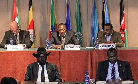 South Sudan's President Kiir and rebel commander Machar attend the signing a ceasefire agreement during the IGAD Summit on the case of South Sudan in Addis Ababa