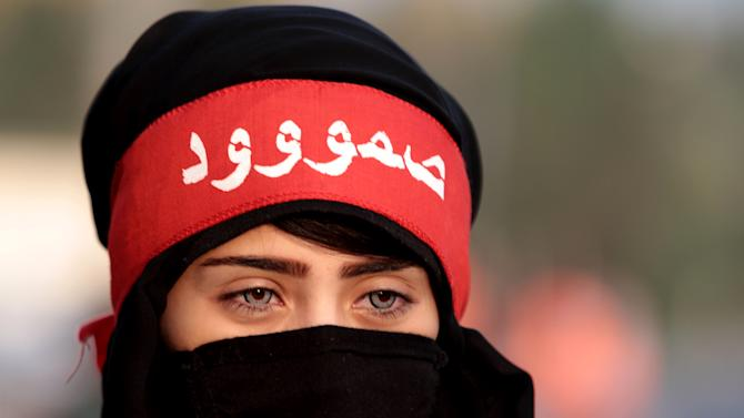 """A Bahraini anti-government protester wears a headband that reads """"steadfast"""" during clashes with riot police in Sanabis, Bahrain, Tuesday, Feb. 12, 2013. Clashes erupted at the end of an anti-government march, when hundreds of youths attempted to reach the heavily guarded site of the 2011 pro-democracy uprising. (AP Photo/Hasan Jamali)"""