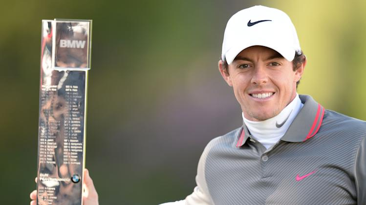 Northern Ireland's Rory Mcilroy celebrates winning the BMW PGA Championship at the Wentworth Club, Virginia Water, Sunday May 25, 2014