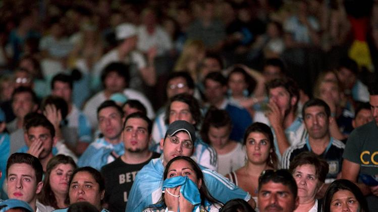 A group of mostly Argentine soccer fans watch a live broadcast of the World Cup final soccer match between Germany and Argentina on a giant screen in Madrid, Spain Sunday July 13, 2014. Germany won the final 1-0