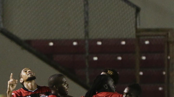 Trinidad and Tobago's Radanfah Abu Bakr, left, celebrates with teammates after scoring against Panama during a friendly soccer match in Panama City, Thursday, Oct. 8, 2015. (AP Photo/Arnulfo Franco)