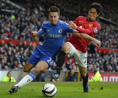 Manchester United's Shinji Kagawa challenges Chelsea's Azpilicueta during their English FA Cup quarter-final soccer match at Old Trafford in Manchester