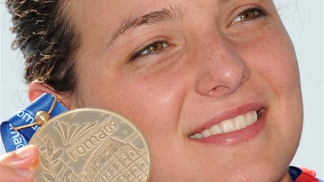 Keri-Anne Payne of Britain displays her gold medal after winning the women's 10 km open water race at the swimming world championships in the Roman seaside resort town of Ostia