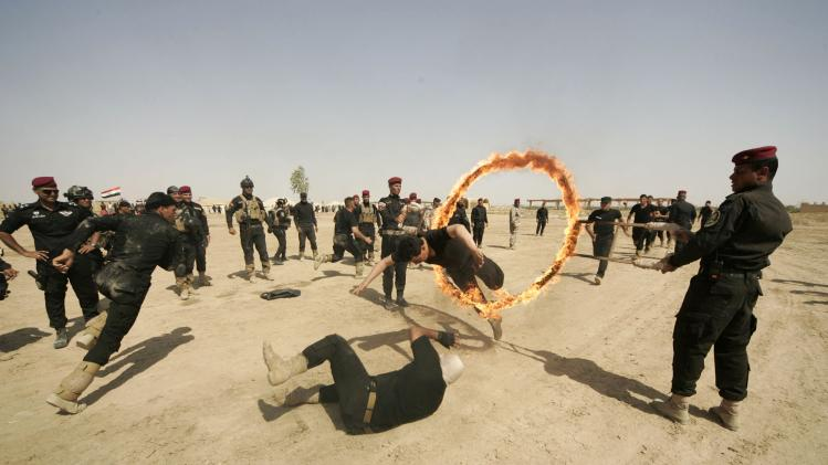 Iraqi Special police officers demonstrate skills during graduation ceremony in Kerbala