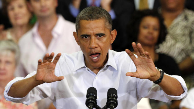 President Barack Obama gestures during a campaign stop at Green Run High School in Virginia Beach, Va., Friday, July 13, 2012. ( AP Photo/Steve Helber)