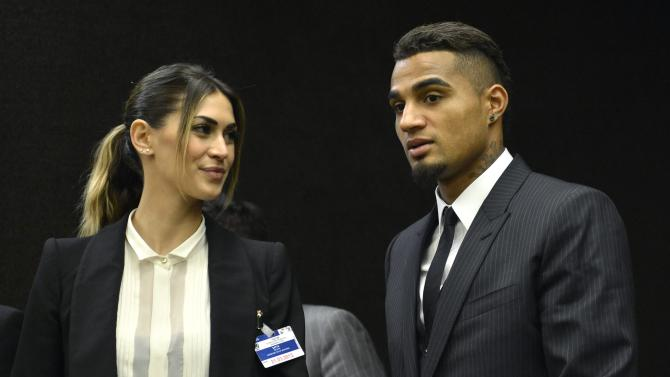 AC Milan's  Kevin-Prince Boateng, right, stands with his girlfriend Melissa Satta, left, after a panel  discussion on Racism and Sport, during the World Humanitarian Day, at the European headquarters of the United Nations in Geneva, Switzerland, Thursday, March 21, 2013.   (AP Photo/Keystone,Martial Trezzini)