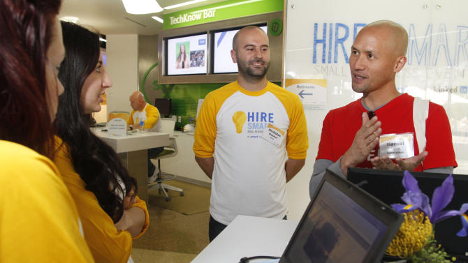 IMAGE DISTRIBUTED FOR INTUIT - A small business owner, right, interacts with Intuit employees at the company's first ever Hire Smart Small Business Event on Saturday, April, 27, 2013 in Mountain View, Calif. The event offered small business owners free resources and expert advice for hiring employees. (Photo by George Nikitin/Invision for Intuit/AP Images)