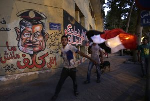 Graffiti, including a caricature of President Mohammed…