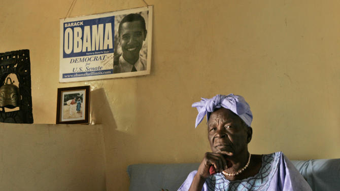 FILE - In this Tuesday, Feb. 5, 2008 file photo, Sarah Obama, step-grandmother of U.S. Democratic presidential hopeful Barack Obama, sits in the living room of her house in the village of Kogelo, near the shores of Lake Victoria, in western Kenya. President Barack Obama promised to visit his father's homeland of Kenya before the end of his presidency but of the 51 country visits Obama made in the last four years, America's first black president spent less than a day in sub-Saharan Africa. Obama is likely to spend more time in Africa in his second term, a presidential historian said. Freed of domestic campaign politics, second-term presidents can travel more in a continent that has less strategic importance than Europe and Asia. (AP Photo/Ben Curtis, File)