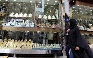 A woman walk past a window display in a gold market in Dubai. The UAE is home to more than 8mln people, only 950,000 of them UAE citizens. The rest are foreign, and young Emirati men are increasingly choosing to marry them instead