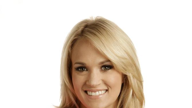 """This April 19, 2012 photo shows Carrie Underwood in Nashville, Tenn. Underwood's latest release """"Blown Away,"""" was released Tuesday, May 1. (AP Photo/Mark Humphrey)"""