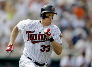 Minnesota Twins' Justin Morneau runs after hitting bases loaded double to bring in three runs in the fourth inning of an exhibition spring training baseball game against the Pittsburgh Pirates, Monday, Feb. 25, 2013, Fort Myers, Fla. Unlike Russell Martin, Morneau says he's willing to play anywhere for Canada at the World Baseball Classic. THE CANADIAN PRESS/AP/David Goldman