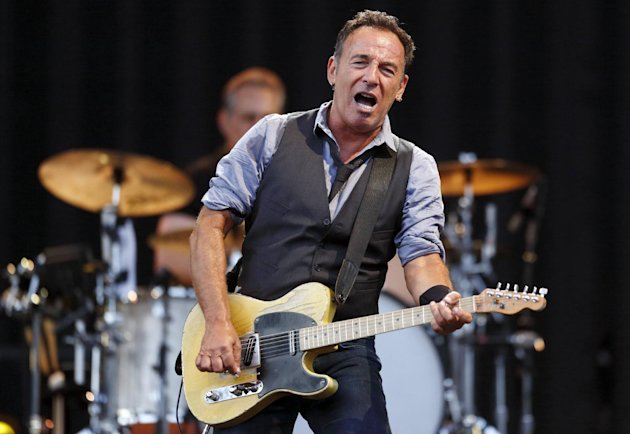 FILE - This Aug. 14, 2012 file photo shows Bruce Springsteen performing at Fenway Park in Boston. NBC is holding a benefit concert for victims of Hurricane Sandy featuring some artists native to the areas hardest hit. Bruce Springsteen and Jon Bon Jovi of New Jersey and Billy Joel of Long Island are scheduled to appear at the concert Friday, Nov. 2. (AP Photo/Michael Dwyer, file)
