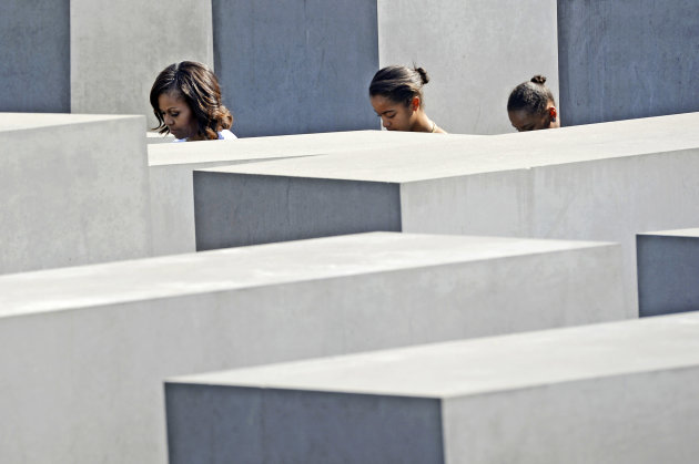 U.S. first lady Michelle Obama and her daughters Malia and Sasha visit the Holocaust Memorial in Berlin