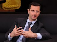 Syrian President Bashar al-Assad answers questions during an interview with a Turkish newspaper Cumhuriyet in Damascus, on July 3, 2012. Assad has reshuffled his cabinet as regime warplanes raided rebel areas in a bid to end the stalemate in Syria's deadly civil war and hopes for a political solution appeared to founder