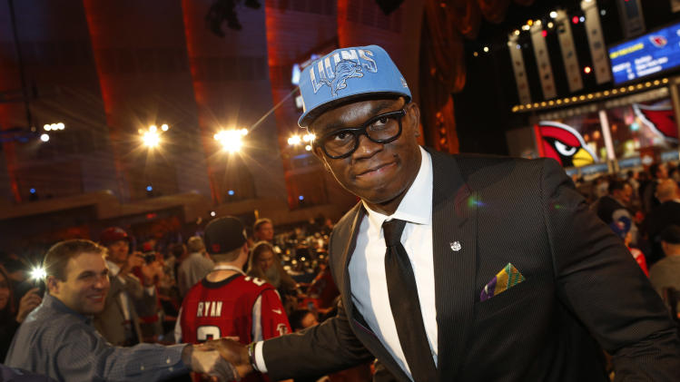 IMAGE DISTRIBUTED FOR NIKE - Ziggy Ansah, defensive end from Brigham Young University, greets fans as he walks through the floor of Radio City Music Hall after being selected as the fifth overall pick by the Detroit Lions after the first round of the 2013 NFL Draft, Thursday, April 25, 2013, in New York City, New York. (John Minchillo/AP Images for NIKE)