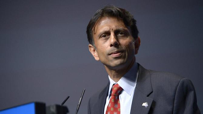 "FILE - In this Aug. 30, 2013, file photo, Louisiana Gov. Bobby Jindal addresses attendees during the Americans for Prosperity Foundation's Defending the American Dream Summit in Orlando, Fla. With no end in sight to the federal government shutdown, Republican governors eyeing the 2016 presidential race are pitching themselves as can-do politicians and highlighting records of achievement. ""Republican governors are not going to take it anymore,"" says Jindal, among those state leaders and potential presidential candidates using the shutdown to try to position themselves as outsiders at a time of voter disgust with Congress and anyone connected with Washington. (AP Photo/Phelan M. Ebenhack)"