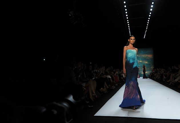 A model walks the runway at the Monique Lhuillier spring 2013 show, Saturday, Sept. 8, 2012, during Fashion Week in New York. (AP Photo/Diane Bondareff)