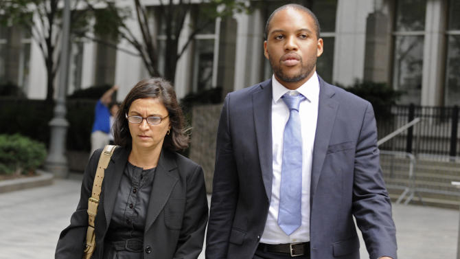 """FILE - In this Oct. 6, 2012, file photo, federal defense attorneys Sabrina Shroff, left, and Jerrod Thompson Hicks exit Manhattan federal court, in New York where they were representing Mustafa Kamel Mustafa, charged with conspiring to set up a terrorist training camp in Oregon and of helping abduct 16 hostages, two of them American tourists, in Yemen in 1998. It can be an uncomfortable life for any defense attorney representing unpopular clients, but lawyers who agree to speak on behalf of people accused of plotting to kill Americans in terrorist attacks walk difficult road. But representing every client, regardless of the crime, is the """"very essence of being a federal defender,"""" said Shroff, an assistant federal defender. (AP Photo/ Louis Lanzano, File)"""