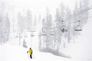 Skiers enjoy the first significant snowfall of 2014 at Sugar Bowl Ski Resort in Norden.