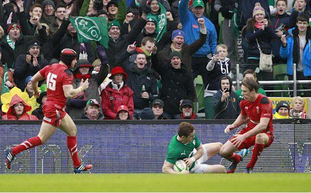 Ireland fans celebrate after Paddy Jackson, centre, scores a try against Wales during their Six Nations Rugby Union international match at the Aviva Stadium, Dublin, Ireland, Saturday, Feb. 8, 2014. (