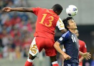Japan's forward Ryoichi Maeda (right) fights for the ball with Oman's defender Abdul Sallam Amur Juma Al Mukhaini during their World Cup 2014 football qualification match. Asian Cup holders Japan beat Oman 3-0 in the first match of the final Asian qualifying round for the 2014 World Cup