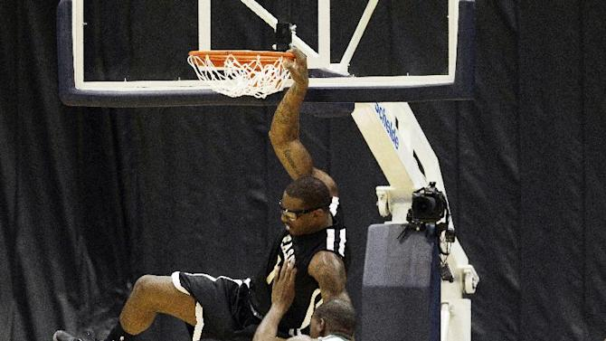 Oklahoma City Thunder's Kevin Durant (35) is unable to stop New York Knicks Amar'e Stoudemire (1) from dunking a ball during the first half of the South Florida All Star Classic basketball game in Miami, Saturday, Oct. 8, 2011. (AP Photo/J Pat Carter)