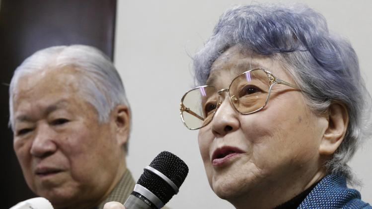 Sakie Yokota, mother of Megumi Yokota who was abducted by North Korea agents at age 13 in 1977, answers questions from the media with her husband during a news conference in Kawasaki