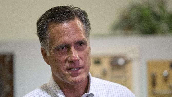 Republican presidential candidate, former Massachusetts Gov. Mitt Romney arrives at LaValley Building Supply Inc., to conduct television interviews, Wednesday, Sept. 5, 2012, in West Lebanon, N.H.  (AP Photo/Evan Vucci)