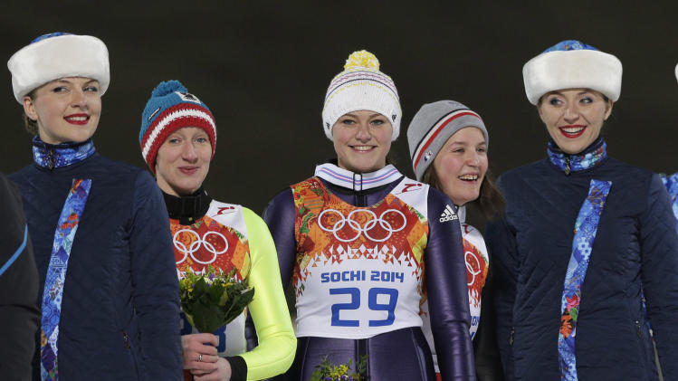 Vogt wins 1st gold medal in Olympic ski jumping