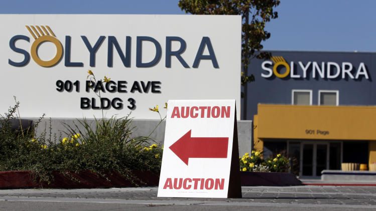 FILE - This Monday, Oct. 31, 2011 file photo shows an auction sign at the bankrupt Solyndra headquarters in Fremont, Calif. before an auction. Newly released emails show that, contrary to White House claims, a major donor to President Barack Obama pushed for a loan to a solar energy company that later went bankrupt. The donor, George Kaiser, pushed White House and Energy Department officials for a second loan for Solyndra Inc. in 2010, after the California company had already received a $528 million loan in 2009, the emails show.  The second loan was not approved. Instead, an investment venture controlled by Kaiser made a private loan that resulted in the firm and other investors moving ahead of taxpayers in line for repayment in case of a default by Solyndra. (AP Photo/Paul Sakuma)