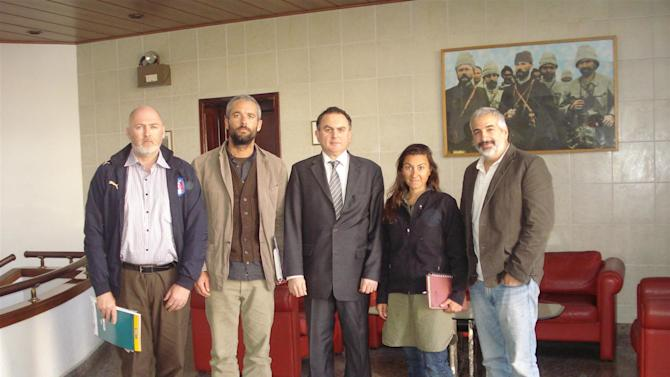 In this March 21, 2011 photo released by the  Turkish Ministry of Foreign Affairs, from left to right, New York Times journalists Stephen Farrell, Tyler Hicks, Ambassdor Levent Sahinkaya, Lynsey Addario and Anthony Shadid pose at the Turkish Embassy in Tripoli, Libya. The four New York Times journalists who had been held by Libya crossed into Tunisia on Monday after being released. (AP Photo/Turkish Ministry of Foreign Affairs)