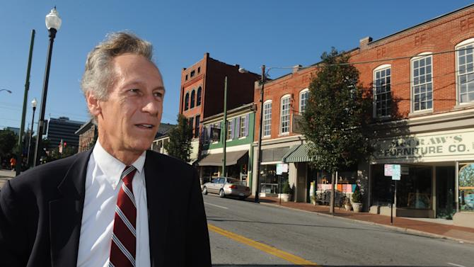 FILE - In this Sept. 13, 2012 file photo, presidential candidate Virgil Goode Jr. works the campaign trail in downtown Lynchburg, Va. Goode knows his obscure presidential run on the Constitution Party ticket vexes his former Republican comrades, a thought that produces a sly smile he can't suppress. He doesn't really try.  (AP Photo/Don Petersen, File)