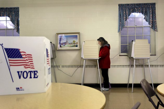 ROYAL OAK, MI - FEBRUARY 28: Carol Kenney fills out her ballot as she votes at the Emmanuel Bethel Church polling station on primary day as Michigan residents head to the polls on February 28, 2012 in Royal Oak, Michigan. Voters head to the polls as the Republican party continues the process of deciding who will be their general election candidate against President Barack Obama.  (Photo by Joe Raedle/Getty Images)