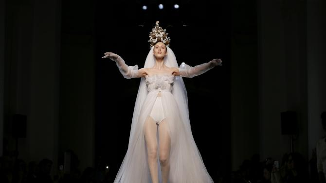 A model presents a creation by French designer Jean Paul Gaultier as part of his Haute Couture Spring Summer 2015 fashion show in Paris