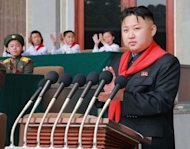 "This photo released by North Korea's official Korean Central News Agency (KCNA) on June 7 shows North Korean leader Kim Jong-Un (C) making a speech on June 6. South Korea accused North Korea of ""crossing the line"" with its recent threats and insults, and pressed the impoverished country to start repayments for past food aid"