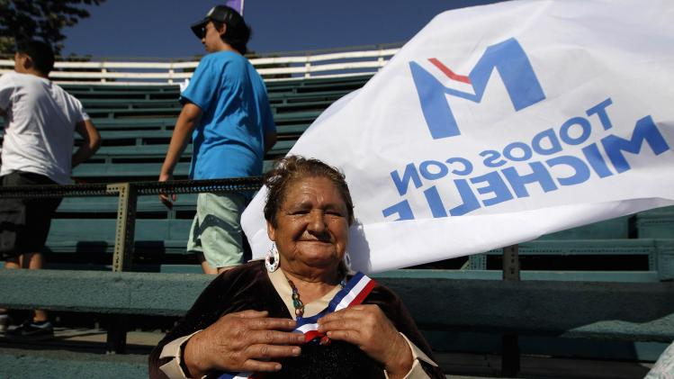 A supporter attends Chilean presidential candidate Bachelet's closing campaign rally in Santiago