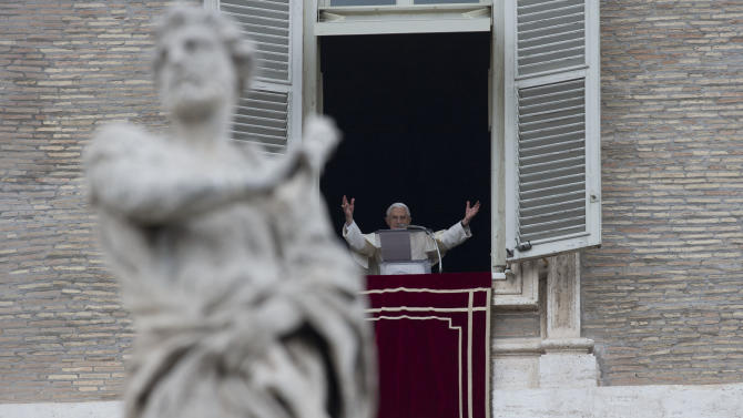 Pope Benedict XVI greets the faithful during the Angelus noon prayer he celebrated from the window of his studio overlooking St. Peter's Square, at the Vatican, Sunday, Nov. 4, 2012. (AP Photo/Andrew Medichini)