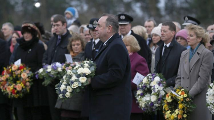 Scotland's First Minister Alex Salmond lays a wreath at a memorial event on the 25th anniversary of the bombing of Pan Am flight 103, in the Dryfesdale Cemetry, in Lockerbie, Scotland