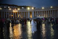 A general view shows people gathering on St Peter's Square waiting for the smoke announcing the result of the first vote of the conclave on March 12, 2013 at the Vatican