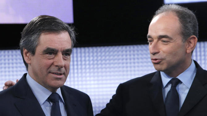 FILE - In this Oct.25, 2012 file photo, former French Prime Minister Francois Fillon, left, and French conservative party UMP secretary general Jean-Francois Cope pose for photographers before a televised debate on French television as they face each other to head the UMP party, in Saint Denis, outside Paris. A mediation effort Sunday Nov.25, 2012 failed to reconcile the Union for a Popular Movement party or figure out who's in charge, seven days after a disputed election for a new party leader. The election a week ago split party members into those leaning toward the anti-immigrant far right, represented by Cope, and those hewing to more centrist views, supporting Fillon. (AP Photo/Christophe Ena, File)