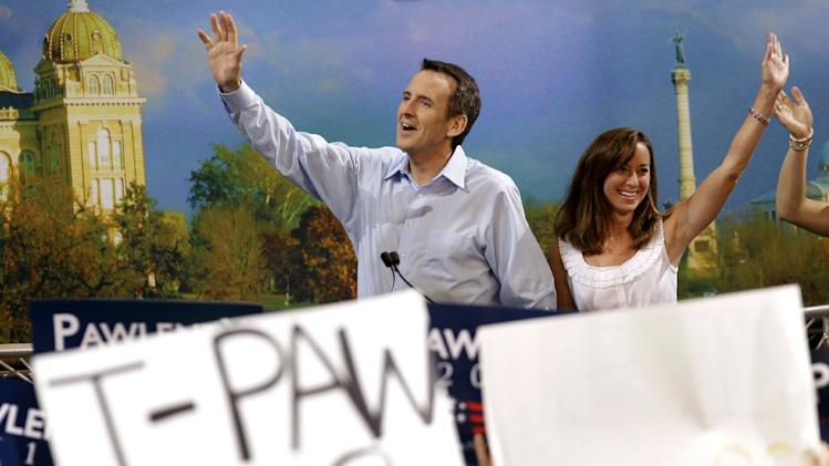 Former Minnesota Governor Tim Pawlenty and his wife Mary wave to supporters before he spoke at the Iowa Republican Party's Straw Poll, Saturday, Aug. 13, 2011, in Ames, Iowa. (AP Photo/Charlie Neibergall)