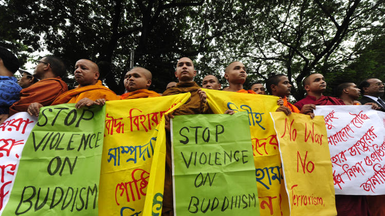 Bangladeshi Buddhist monks stage a protest in Chittagong, Bangladesh, Sunday, Sept. 30, 2012 after Muslims torched Buddhist temples in southern Bangladesh. Thousands of Bangladeshi Muslims angry over an alleged derogatory photo of the Islamic holy book Quran on Facebook set fires in at least 10 Buddhist temples and 40 homes near the southern border with Myanmar, authorities said Sunday. (AP Photo)