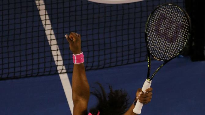 Williams of the U.S. celebrates after defeating Sharapova of Russia in their women's singles final match at the Australian Open 2015 tennis tournament in Melbourne